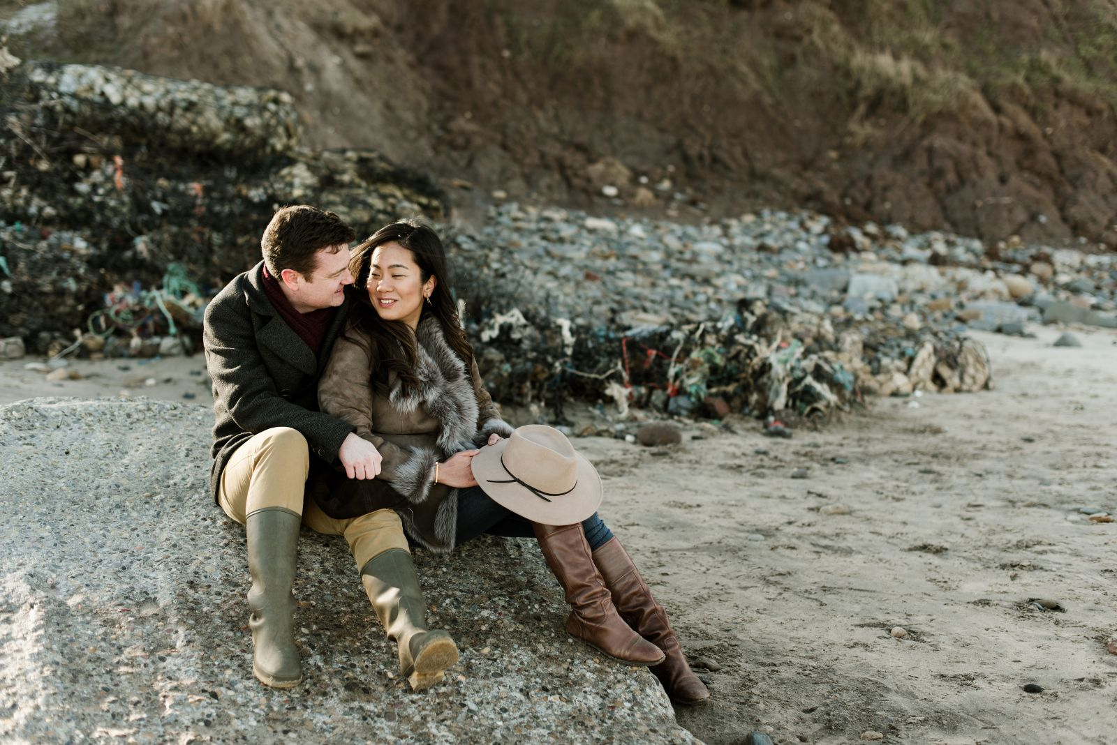 Engagement Photography relaxing on the beach together