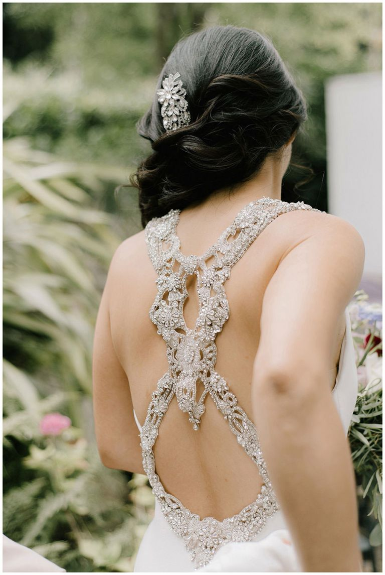 Beautiful movement shot of bride as she goes down garden steps and just shows the back detail of the dress and hair