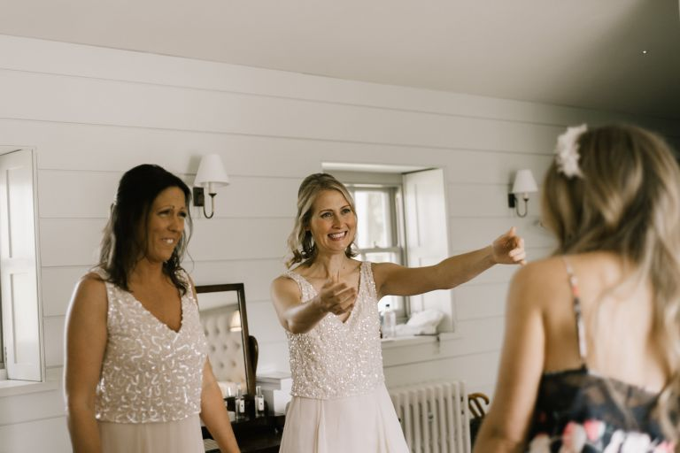 bridesmaids share moment with bride