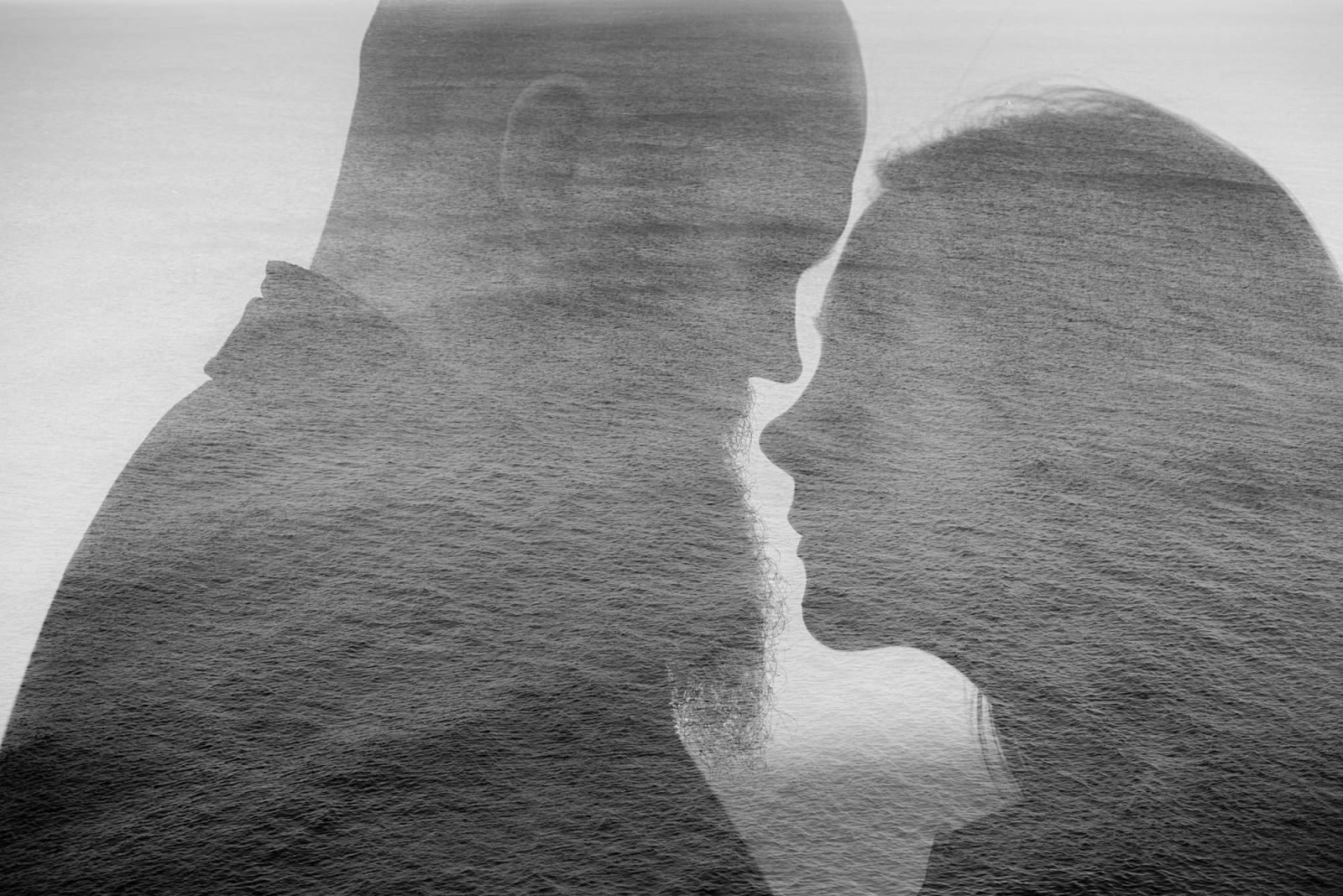 Engagement shoot double exposure with couple and sea