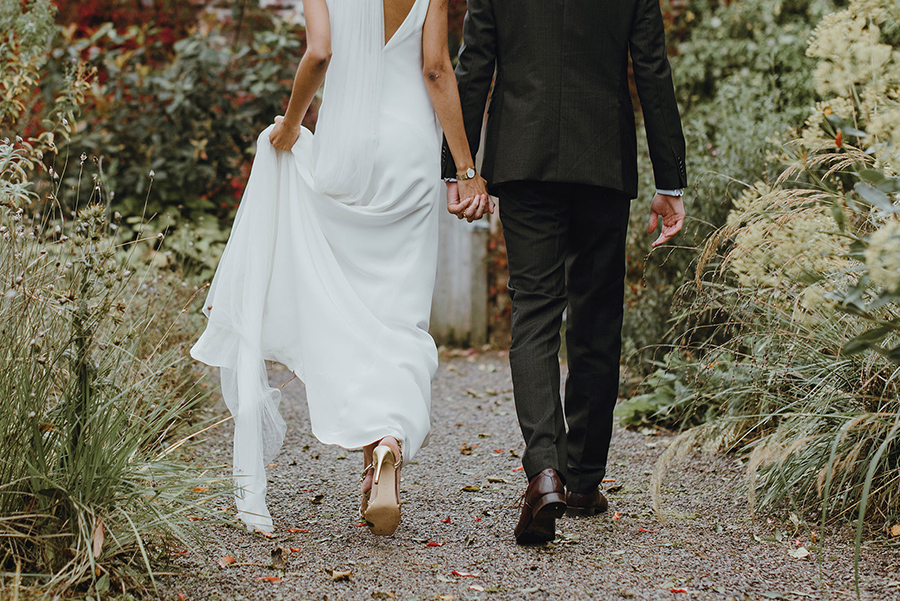 modern wedding image of holding hands