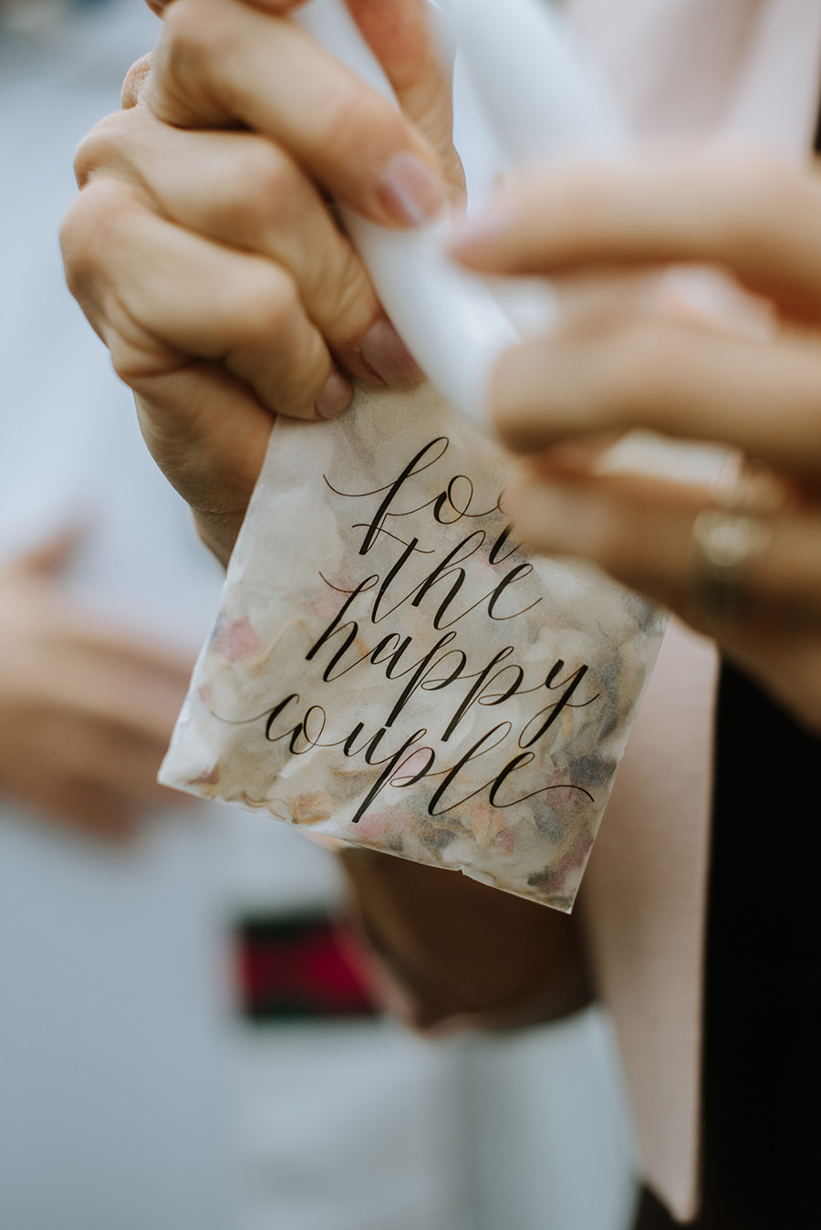 Detail shot of confetti bag held by guest