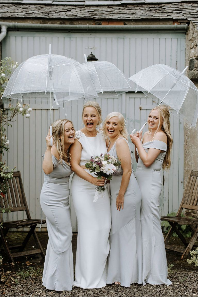 Bridesmaids under umbrellas